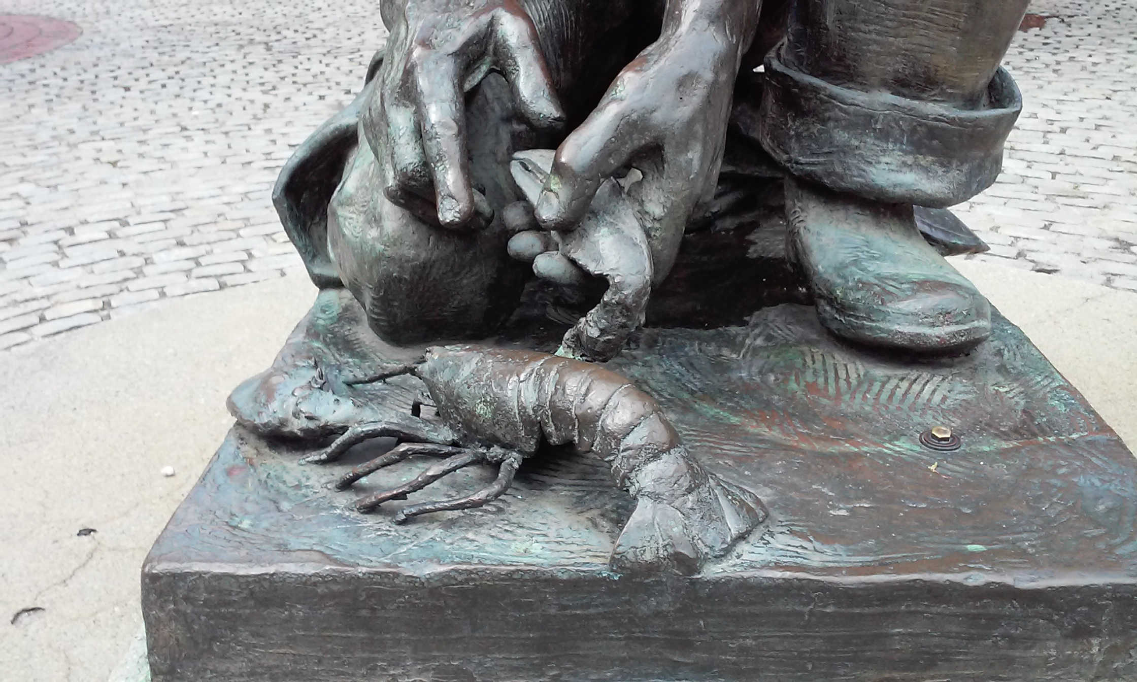 lobster helping hands statue